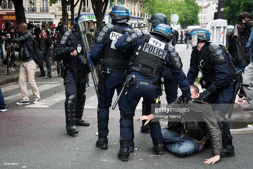 French police intervenes to a protestor during the protest against French government's labor law reform in Paris, France on May 26, 2016.