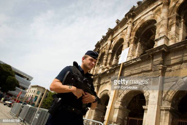 A French police officer patrols at the Arena in Nimes prior to the start of the first stage of the 72nd edition of 'La Vuelta' Tour of Spain cycling...