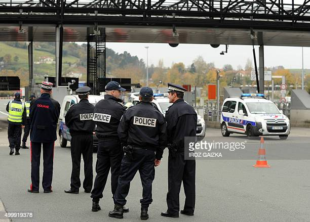 French police officers and customs agents stand at a border post on the FrenchSpanish border on the A63 motorway in Biriatou southwestern France on...