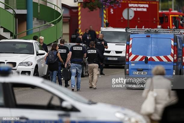 French police officers and fire engine arrive at the scene of a hostagetaking at a church in SaintEtienneduRouvray northern France on July 26 2016...