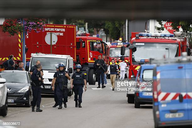French police officers and firemen arrive at the scene of a hostagetaking at a church in SaintEtienneduRouvray northern France on July 26 2016 that...