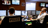 French police officers answer calls made to the '17' emergency number in the command and information room at the police headquarters of Paris on...