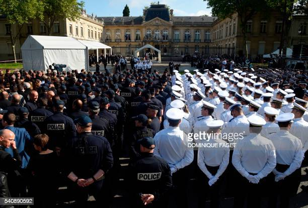 French police officers attend a memorial ceremony honouring the police couple who were killed by an extremist pledging allegiance to the Islamic...