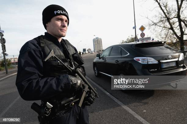 French Police officers carry out checks on vehicles on the 'European bridge' between Strasbourg and Kehl on November 14 as part of security measures...