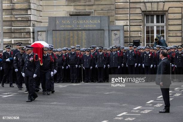 French police officers carry the flagdraped coffin during a ceremony honouring the policeman killed by a jihadist in an attack on the Champs Elysees...