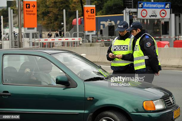 French police officers checks a man's papers at a border post on the FrenchSpanish border on the A63 motorway in Biriatou southwestern France on...