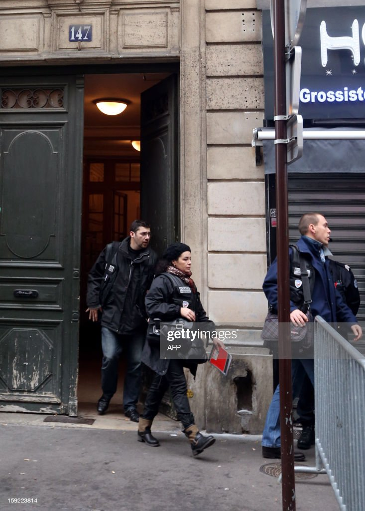 French police officers leave a building hosting the Kurdistan Information Bureau on January 10, 2013, in Paris, where three Kurdish women were found killed with a gunshot to the head. The bodies of the women were found shortly before 2:00 am (0100 GMT) inside the building in the 10th arrondissement of the French capital. One of the women was 32-year-old Fidan Dogan who worked in the institute's information centre, according to its director, Leon Edart. The identities of the other two women, who were reportedly Kurdish activists but did not work at the Institute, were not immediately available. AFP PHOTO / THOMAS SAMSON