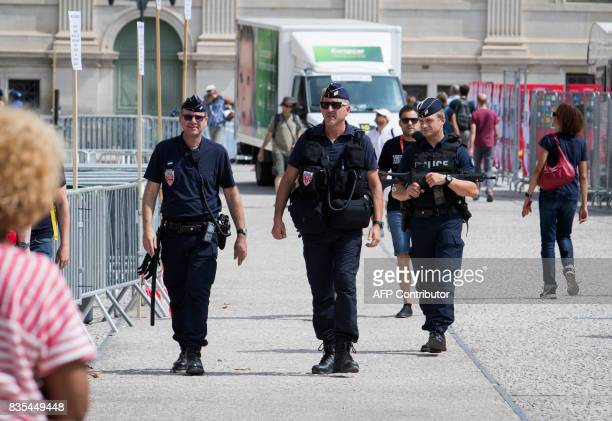 French police officers patrol at the Arena in Nimes prior to the start of the first stage of the 72nd edition of 'La Vuelta' Tour of Spain cycling...