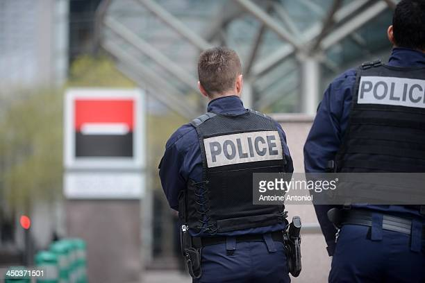 French police officers patrol outside the Societe Generale headquarters at La Defense business district following gun attack on November 18 2013 in...