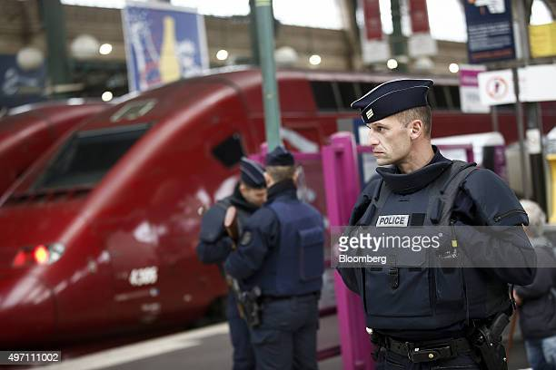 French police officers patrol the platforms at the Gare du Nord train station in Paris France on Saturday Nov 14 2015 French President Francois...