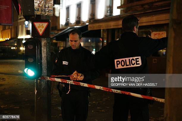 French police officers set up a police cordon outside the building where British photographer David Hamilton was found dead at his home on November...