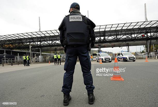 French police officers stand at a border post on the FrenchSpanish border on the A63 motorway in Biriatou southwestern France on December 4 during a...