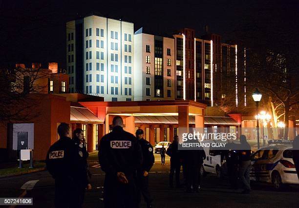 French police officers stand guard after a man carrying two handguns ammunition and a Koran was arrested on January 28 2016 at a hotel in Disneyland...