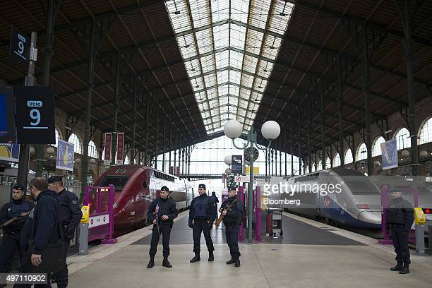 French police officers stand guard at the Gare du Nord train station in Paris France on Saturday Nov 14 2015 French President Francois Hollande...