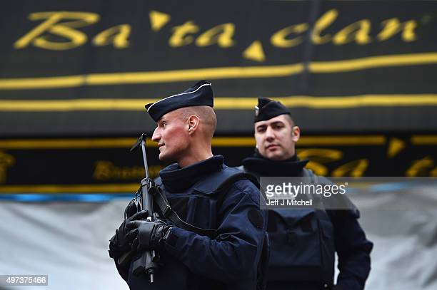 French police officers stand guard in front of the main entrance of Bataclan concert following Friday's terrorist attacks on November 16 2015 in...
