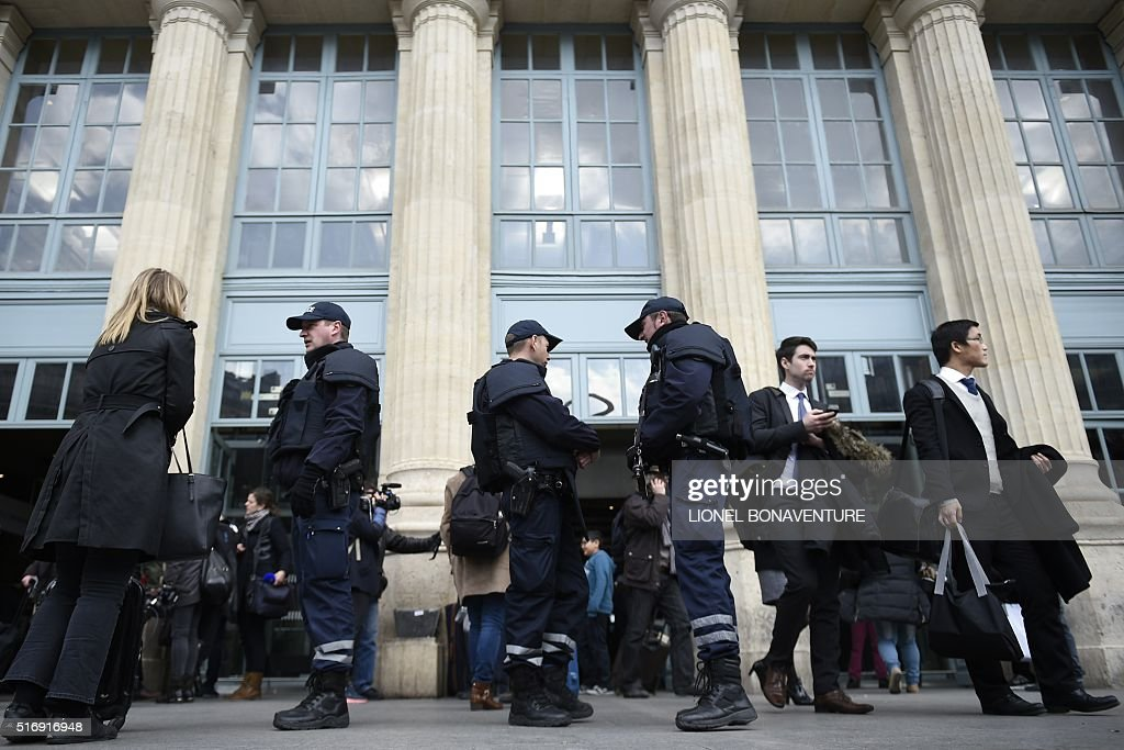 French police officers stand guard outside the Gare du Nord train station in Paris on March 22 as security measures have been reinforced after at...