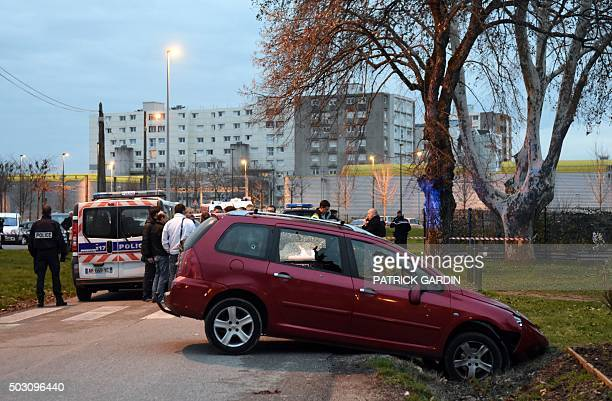 French police officers stand near red car in front of the mosque of Valence southeastern France on January 1 after a soldier guarding the mosque shot...