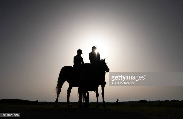 TOPSHOT French Police officers stands guard on their horses as they supervise the 2018 Ryder Cup media day on October 16 2017 at the Golf National in...