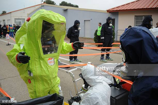 French police officers take part in a simulation of terrorist attack in football fanzone in Nimes on March 17 2016 as part of Euro 2016 The...