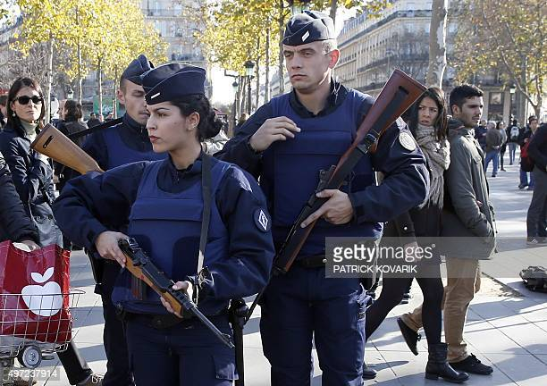 French police patrol at the Monument a la Republique in the Place de la Republique in Paris where people are gathering on November 15 two days after...