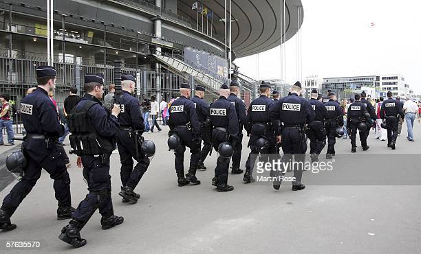 French police patrol outside the stadium prior to the UEFA Champions League Cup Final between Arsenal and Barcelona at the Stade de France on May 17...