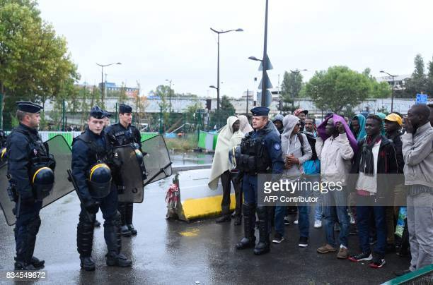 French police ready to evacuate migrants from a makeshift camp at Porte de la Chapelle in the north of Paris on August 18 2017 More than a thousand...