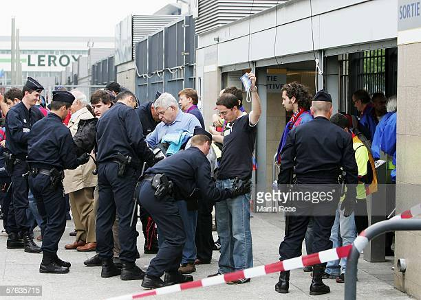 French police search fans as they enter the stadium prior to the UEFA Champions League Cup Final between Arsenal and Barcelona at the Stade de France...