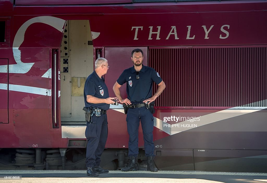 French police stand guard along the platform next to a Thalys train of French national railway operator SNCF at the main train station in Arras...