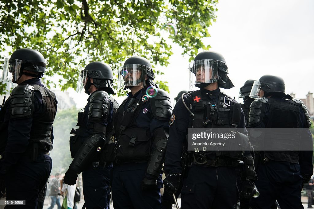 French police stand guard during the protest against French government's labor law reform in Paris, France on May 26, 2016.