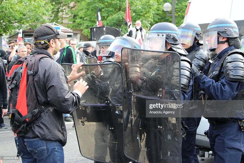 French police stand guard during the protests against French government's labor law reform in Paris, France on May 26, 2016.