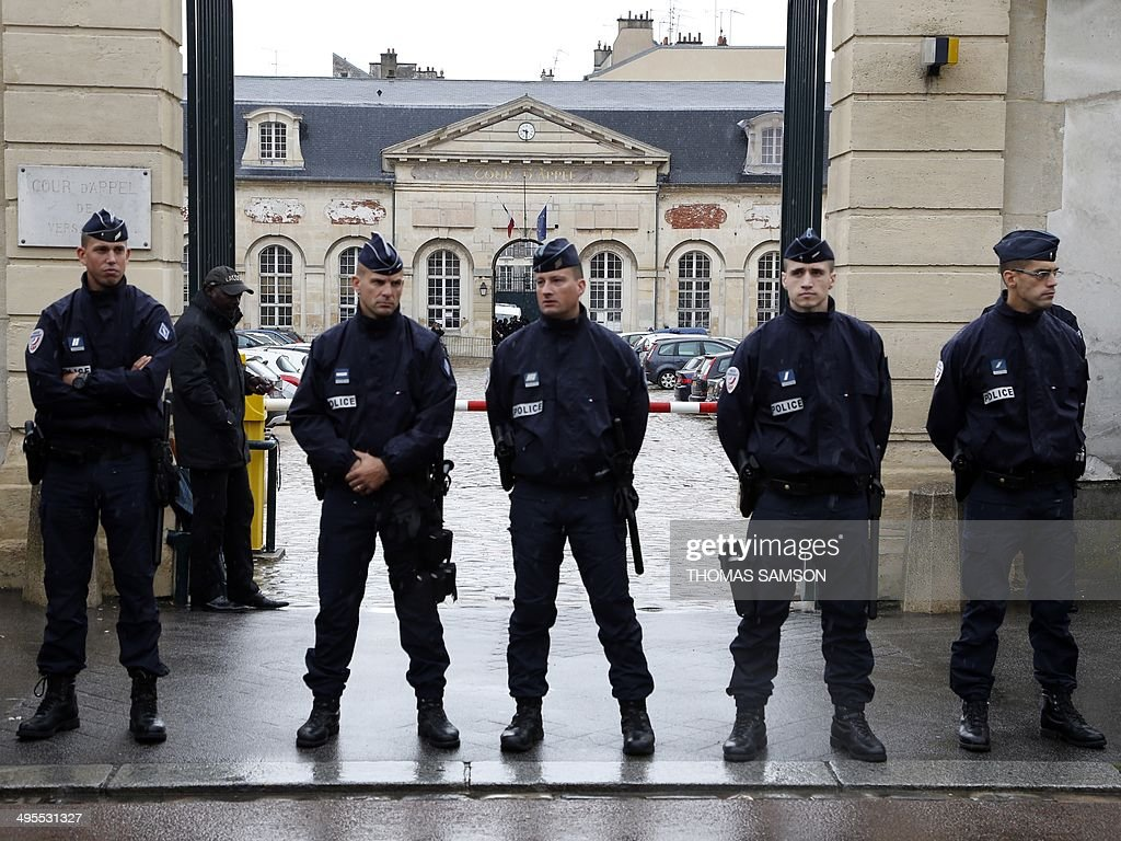 French police stand guard outside the Appeal court of Versailles, west of Paris, before the arrival of Brussels shooting suspect Mehdi Nemmouche for his appearance before the public prosecutor's office, on June 4, 2014. France on June 3 increased its estimate of the number of its nationals embroiled in Syria's civil war to more than 800 and warned that they pose an unprecedented security threat. AFP PHOTO / THOMAS SAMSON