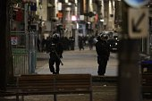 French Police stand in position as Police special forces raid an appartment hunting those behind the attacks that claimed 129 lives in the French...