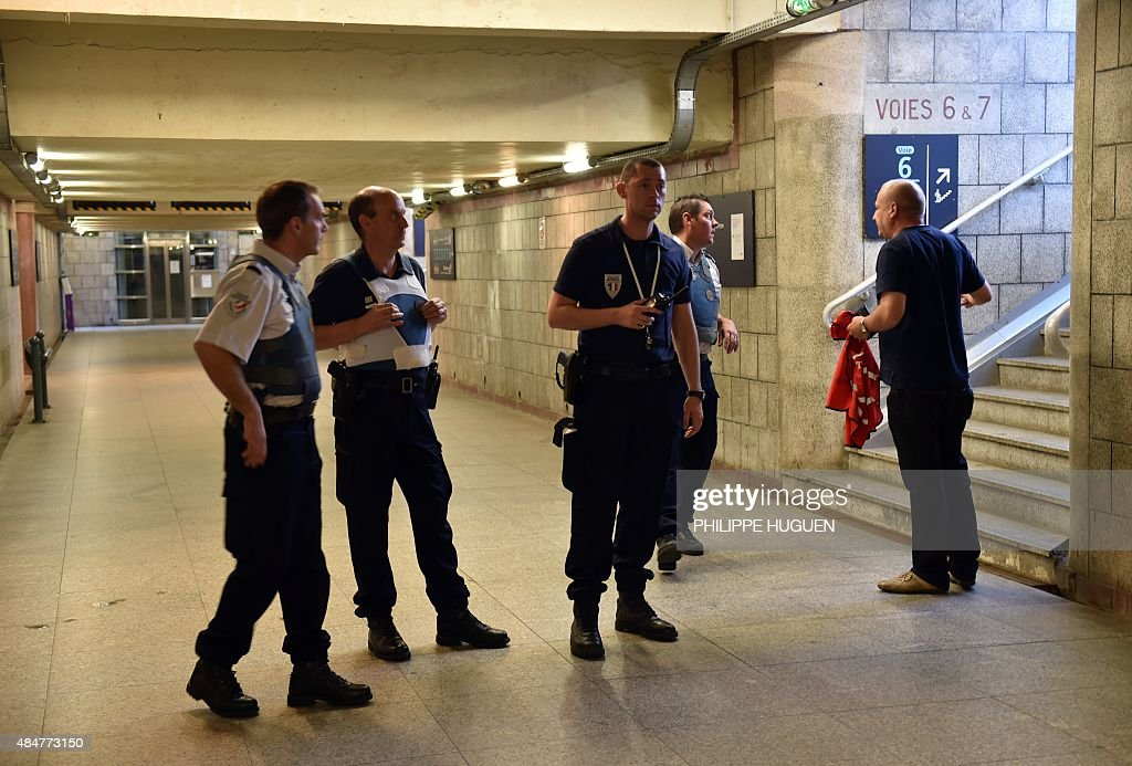 French police stand inside the main train station in Arras northern France on August 21 2015 A gunman opened fire on a train travelling from...
