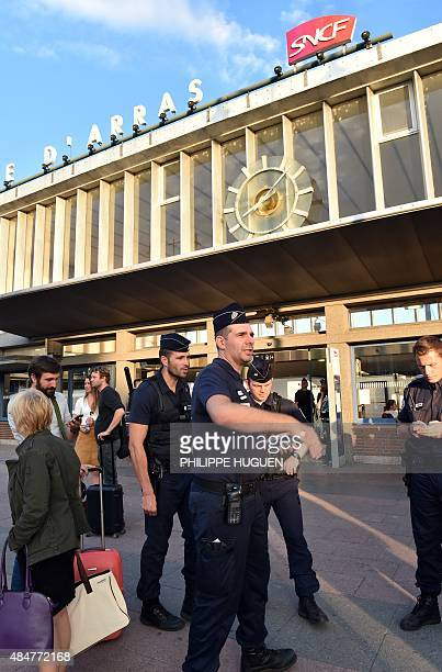French police stand outside the main train station in Arras northern France on August 21 2015 A gunman opened fire on a train travelling from...