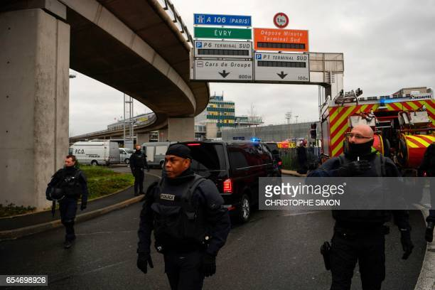 French Police unit secure the area at Paris' Orly airport on March 18 2017 following the shooting of a man by French security forces Security forces...