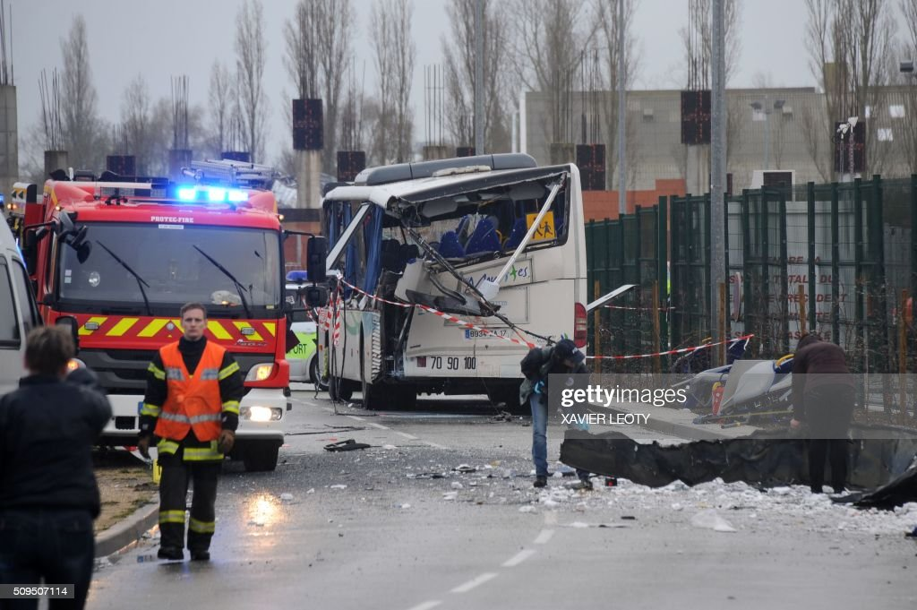 French police work near the wreckage of a school minibus after it crashed into a truck near Rochefort on February 11, 2016, killing at least six children, police said, a day after another road accident involving a school bus left two youngsters dead. The head-on smash with a lorry carrying rubble came around 7:15 am (0615 GMT) near Rochefort in the western Charente-Maritime region. / AFP / XAVIER LEOTY