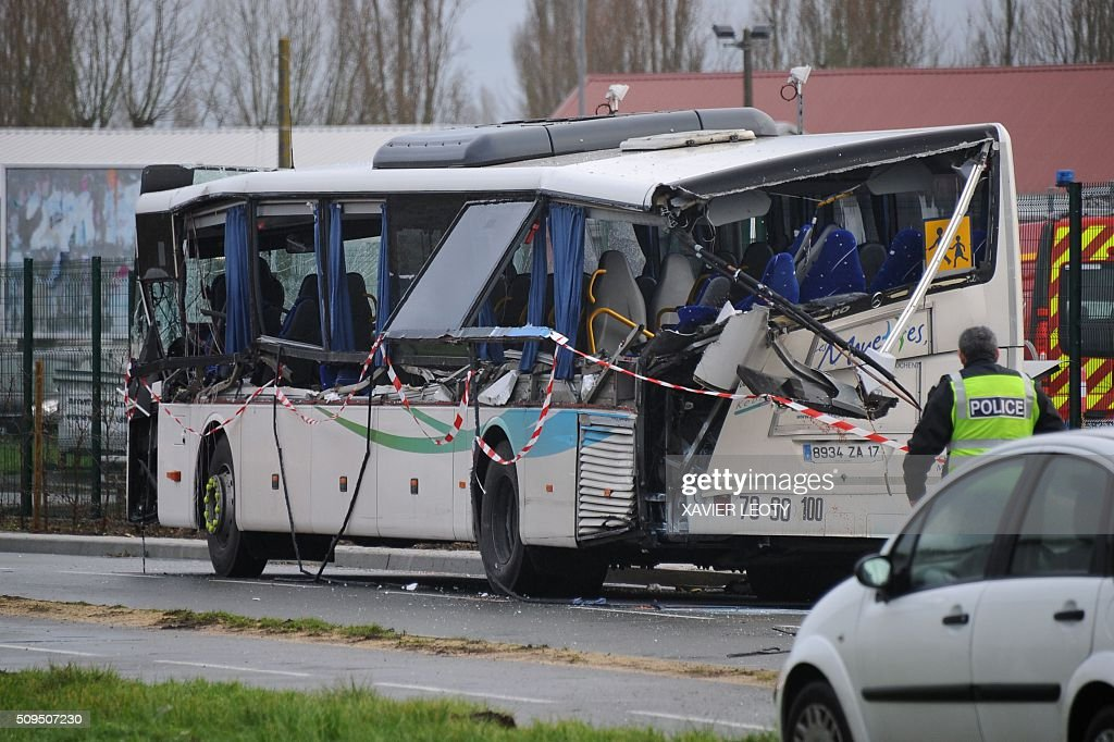 French police work near the wreckage of a school minibus after it crashed into a truck in Rochefort on February 11, 2016, killing at least six children, police said, a day after another road accident involving a school bus left two youngsters dead. The head-on smash with a lorry carrying rubble came around 7:15 am (0615 GMT) near Rochefort in the western Charente-Maritime region. / AFP / XAVIER LEOTY