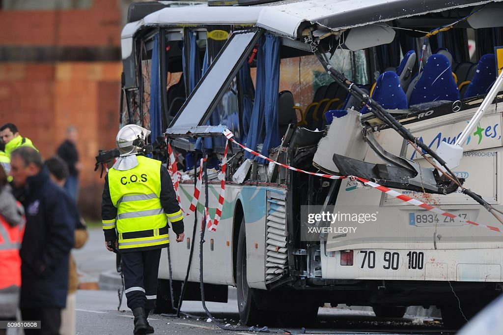 French police work near the wreckage of a school minibus after it crashed into a truck in Rochefort on February 11, 2016, killing at least six children, police said, a day after another road accident involving a school bus left two youngsters dead. The head-on smash with a lorry carrying rubble came around 7:15 am (0615 GMT) in Rochefort in the western Charente-Maritime region. / AFP / XAVIER LEOTY