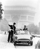 French Policeman aid tourists outside Arc de Triomphe in Paris France 1955