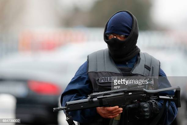A French policeman secures the area at Paris' Orly airport on March 18 2017 following the shooting of a man by French security forces Troops at...