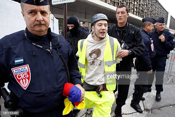 French policemen arrest a man protesting for free Tibet in front the train station on November 2 in Cannes southeastern France on the eve of the G20...