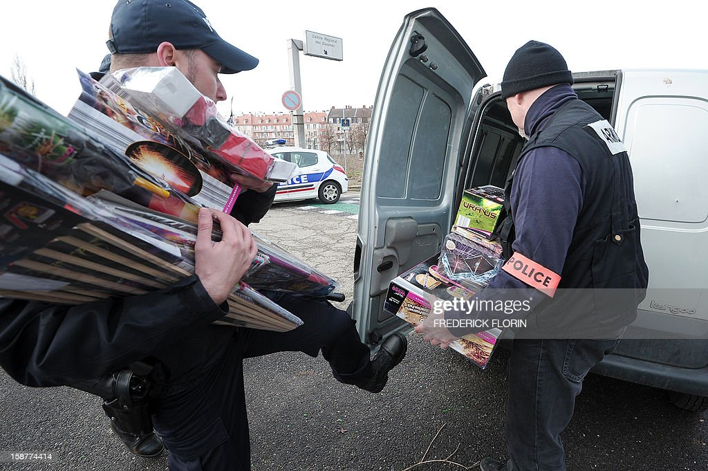 French policemen confiscate fireworks as they control cars on December 28, 2012 at the border between France and Germany in the eastern French city of Strasbourg. Tighter controls are organised at the border, three days ahead of the New Year's eve, as legislation on firecrackers and fireworks is less restrictive in Germany than in France.