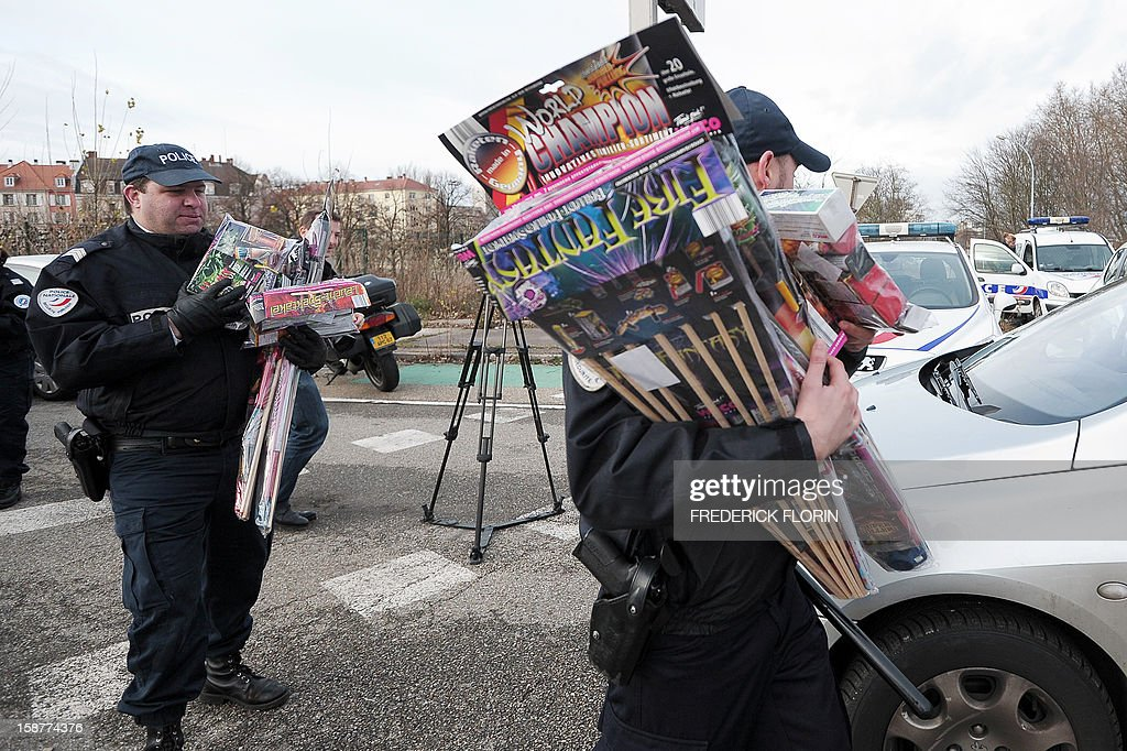French policemen confiscate fireworks on December 28, 2012 at the border between France and Germany in the eastern French city of Strasbourg. Tighter controls are organised at the border, three days ahead of the New Year's eve, as legislation on firecrackers and fireworks is less restrictive in Germany than in France. AFP PHOTO/FREDERICK FLORIN