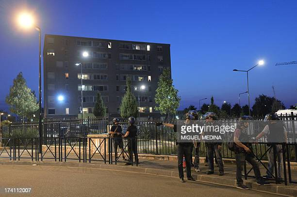 French policemen from the anticrime unit patrol in the streets on July 20 2013 in Trappes a suburb of Paris Violent clashes erupted between citizens...