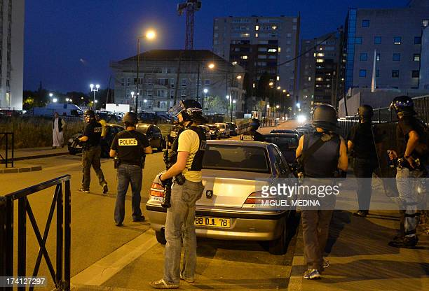 French policemen from the anticrime unit patrol the streets in Trappes a suburb of Paris on July 20 2013 Violent clashes erupted between citizens and...