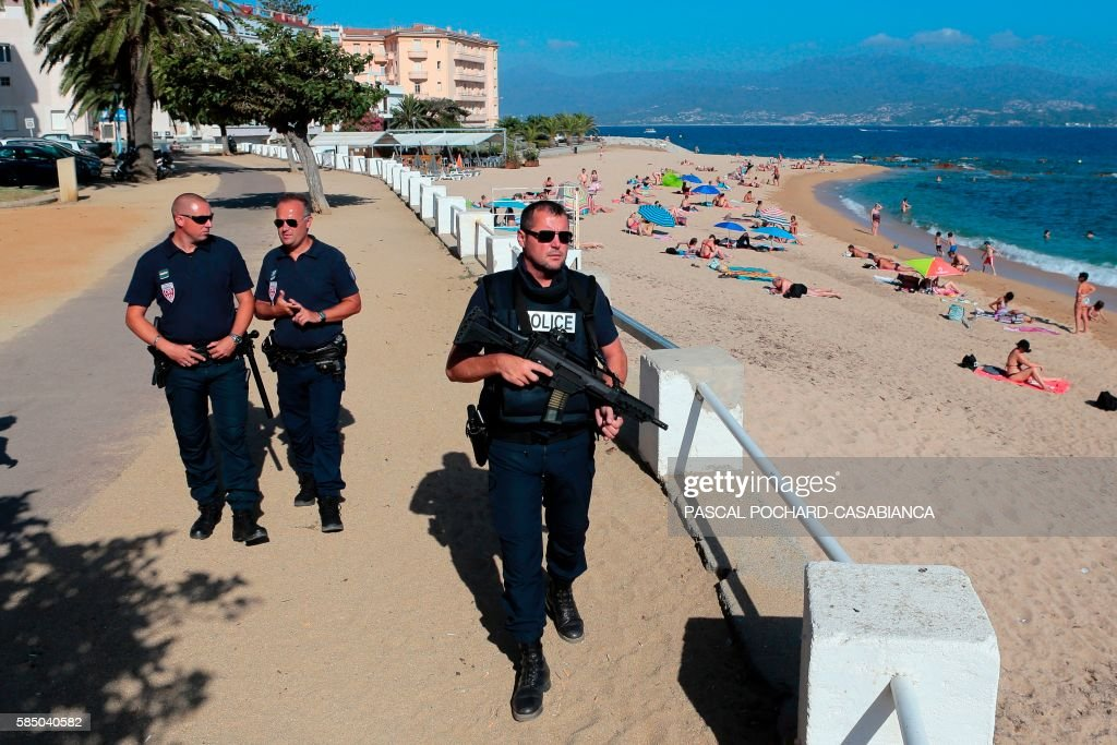 French policemen patrol on August 1 2016 at the Trottel beach in Ajaccio on the French Mediterranean island of Corsica / AFP / PASCAL...