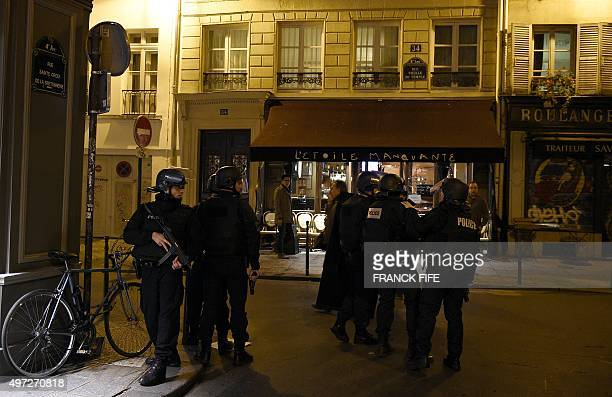 French policemen patrol rue Sainte Croix de la Bretonnerie in the Marais district in Paris on November 15 2015 Islamic State jihadists claimed a...