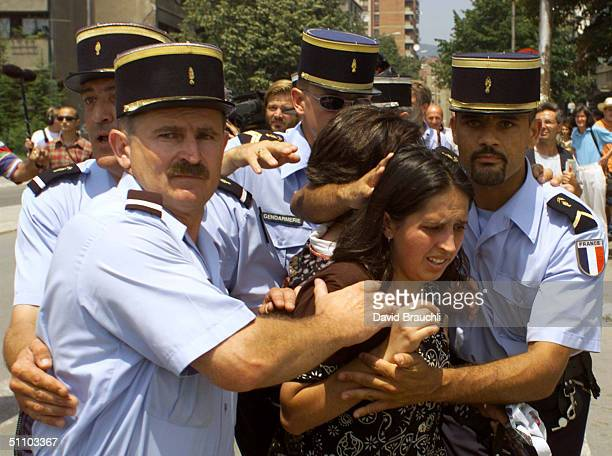 French Policemen Protect Two Ethnic Albanian Women From Flying Stones And Sticks On The North Side Of A Bridge Which Divides Mitrovica A Town Some 40...