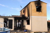 French policemen search index a house where five people were found dead on January 22 2013 in Garons near Nimes southern France The bodies of two...
