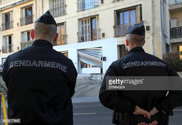 French policemen stand guard near a prayer hall on December 26 2015 after demonstrators ransacked a Muslim prayer hall and attempted to burn copies...